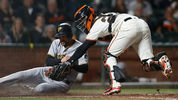 SAN FRANCISCO, CA - AUGUST 09: Jordy Mercer #10 of the Pittsburgh Pirates is tagged out at home plate by catcher Buster Posey #28 of the San Francisco Giants in the seventh inning at AT&T Park on August 9. (Photo by Lachlan Cunningham/Getty Images)
