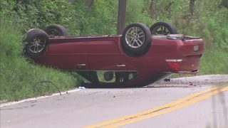 Road rage incident ends with car flipping, woman going to hospital