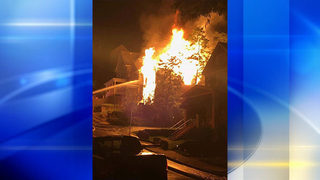 Woman hospitalized after jumping to escape flames at home