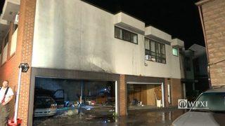 Suspicious garage fire forces evacuation of apartments