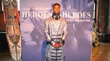 "Guests wear African inspired fashion to the ""Heroes and Sheroes"" opening gala at the Heinz History Center. The exhibit with ""Black Panther"" costumes is open until Dec. 2."