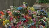 Decorations removed from graves, dumped in pile at local cemetery
