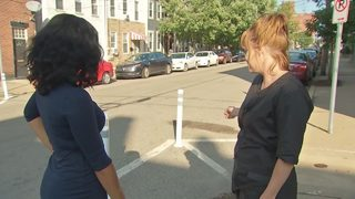 Residents, business frustrated by mysterious appearance of poles in street