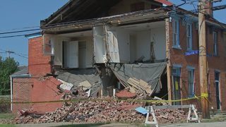 Wall of building collapses days after damage noticed
