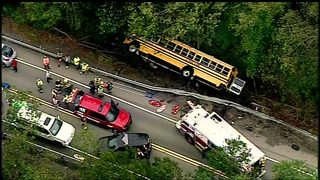 School bus carrying 40 students crashes over embankment