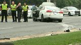 VIDEO: Four students hit by car while waiting for bus