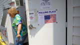 A voter exits the Glen Lyon Italian American Sporting Club polling station after casting her ballot during the 2018 Pennsylvania Primary Election on May 15, 2018 in Glen Lyon, Pennsylvania. (Photo by Mark Makela/Getty Images)