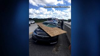 Sheet of plywood impales car windshield