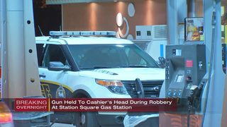 Police search for men who held gun to clerk