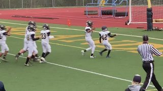 Boy with special needs scores his first touchdown