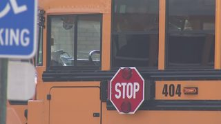 Man forced his way onto school bus, yelled racial slurs in front of kids, police say