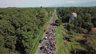RAW VIDEO: Drone over migrant caravan