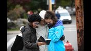Tammy Hepps, Kate Rothstein and her daughter, Simone Rothstein, 16, pray from a prayerbook near the site of a mass shooting at the Tree of Life Synagogue on October 27, 2018 in Pittsburgh, Pennsylvania. (Photo by Jeff Swensen/Getty Images)
