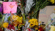 PITTSBURGH, PA - OCTOBER 28: Flowers and cards sit at a makeshift memorial down the street from the site of the mass shooting that killed 11 people and wounded 6 at the Tree Of Life Synagogue on October 28, 2018 in Pittsburgh, Pennsylvania. Suspected gunman Richard Bowers, 46, has been charged with 29 federal counts in the mass shooting that police say was fueled by antisemitism. Suspected gunman Richard Bowers, 46, has been charged with 29 federal counts in the mass shooting that police say was fueled by antisemitism. (Photo by Jeff Swensen/Getty Images)