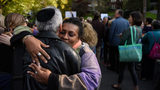 Two protesters hug during a march for solidarity while President Donald Trump was visiting October 30, 2018 in Pittsburgh, Pennsylvania. (Photo by Jeff Swensen/Getty Images)