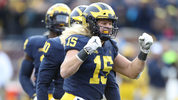 Chase Winovich celebrates a second quarter sack during the game against the Penn State Nittany Lions at Michigan Stadium on November 3, 2018 in Ann Arbor, Michigan. (Photo by Leon Halip/Getty Images)