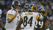 BALTIMORE, MD - NOVEMBER 04: Quarterback Ben Roethlisberger #7 of the Pittsburgh Steelers celebrates with wide receiver Antonio Brown #84 after a play in the third quarter against the Baltimore Ravens at M