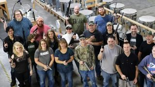 VIDEO: Company buys employees guns for Christmas