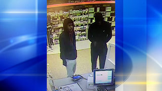 Police seeking 2 who robbed pharmacy at gunpoint