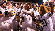 CHARLOTTESVILLE, VA - NOVEMBER 02: Jazzee Stocker #7 of the Pittsburgh Panthers celebrates with teammates after a game against the Virginia Cavaliers at Scott Stadium on November 2, 2018 (Photo by Ryan M. Kelly/Getty Images)