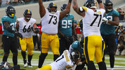 JACKSONVILLE, FL - NOVEMBER 18: Ben Roethlisberger #7 of the Pittsburgh Steelers dives for the go-ahead touchdown as other Steelers celebrate during the second half against the Jacksonville Jaguars. (Photo by Scott Halleran/Getty Images)
