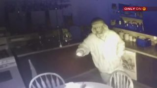 Man caught on camera rummaging through house while couple slept upstairs