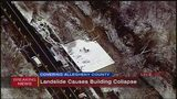 Building partially collapses because of landslide