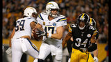 PITTSBURGH, PA - DECEMBER 02: Philip Rivers #17 of the Los Angeles Chargers scrambles under pressure from Terrell Edmunds #34 of the Pittsburgh Steelers in the first half during the game at Heinz Field. (Photo by Justin K. Aller/Getty Images)
