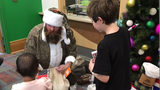Former Pittsburgh Steeler Brett Keisel dresses up as Santa to spread holiday cheer to kids at Children's Hospital.
