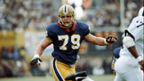 PITTSBURGH - 1983: Offensive lineman Bill Fralic #79 of the University of Pittsburgh Panthers looks to block an opponent during a game at Pitt Stadium in 1983 in Pittsburgh, Pennsylvania. (Photo by George Gojkovich/Getty Images)