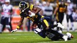 Antonio Brown is wrapped up for a tackle by Stephon Gilmore #24 of the New England Patriots in the first quarter during the game at Heinz Field on December 16, 2018 in Pittsburgh, Pennsylvania. (Photo by Joe Sargent/Getty Images)