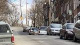 Man found shot to death in running SUV