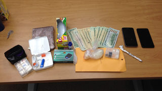 Police make arrest, seize cocaine and heroin during raid