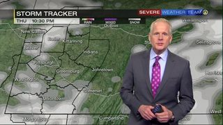 Light snow showers continuing into Friday morning