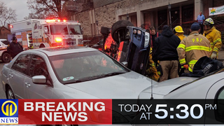Car on side after crash in Squirrel Hill