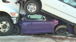 VIDEO: Terrifying crash leaves cars stacked