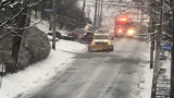 Steep street causes problems during slick morning commute