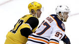 Pittsburgh Penguins' Sidney Crosby (87) and Edmonton Oilers' Connor McDavid play during the third period of an NHL hockey game in Pittsburgh, Wednesday, Feb. 13, 2019. The Penguins won 3-1.(AP Photo/Gene J. Puskar)
