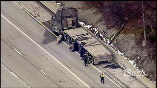 PARKWAY WEST CRASH: Large metal object falls off tractor-trailer