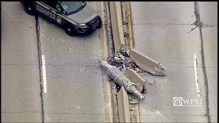 PHOTOS: Large metal object falls off tractor-trailer, smashes Jersey barrier on Parkway West