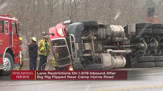 Tractor-trailer overturns on I-279 south