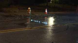 Water trickles up from road after main breaks