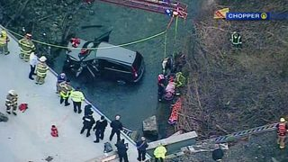 2 women critically hurt, rescued after car crashes over hillside, lands in creek