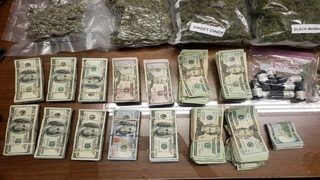 Police confiscate over $100K, several pounds of marijuana and guns during drug bust