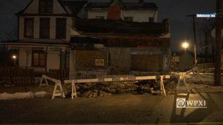 Dozens of bricks fall from building, crash onto sidewalk