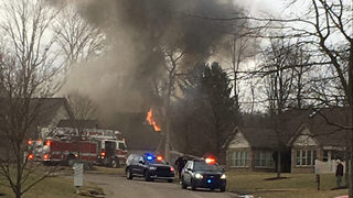 Photos: Townhouses evacuated when fire starts in one
