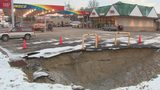 Large sinkhole opens up in gas station parking lot