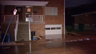 Water from broken main floods part of street, driveway
