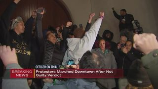 Protesters march downtown following not guilty verdict for Michael Rosfeld