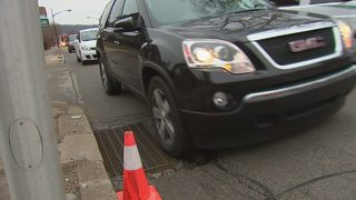 Sinking storm drain creating driving hazard on busy street